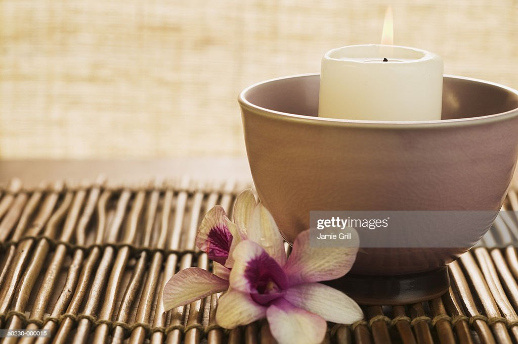 Orchid beside Burning Candle : Stock Photo