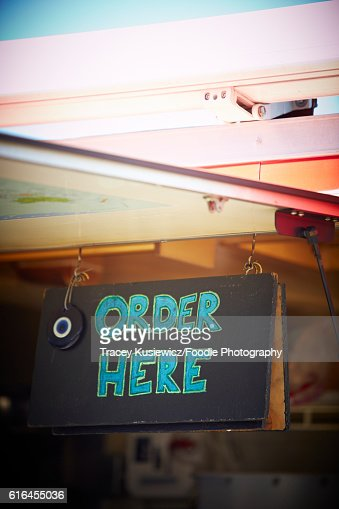Order here sign on a food truck : Stock Photo