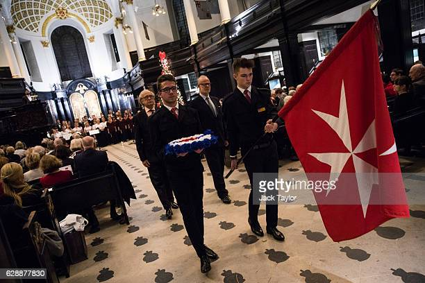 Order of Malta Cadets carry the Order's flag and a wreath during an AngloPolish Carol Service at the St Clement Danes Church on December 9 2016 in...