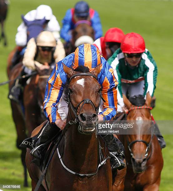 Order Of St George ridden by Ryan Moore leads the field home to win The Gold Cup In Honour Of The Queens 90th Birthday Race run during Day Three of...