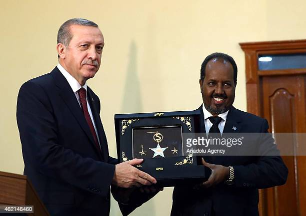 Order of State of Somalia is presented to Turkish President Recep Tayyip Erdogan by Somalian President Hassan Sheikh Mohamoud after a press...