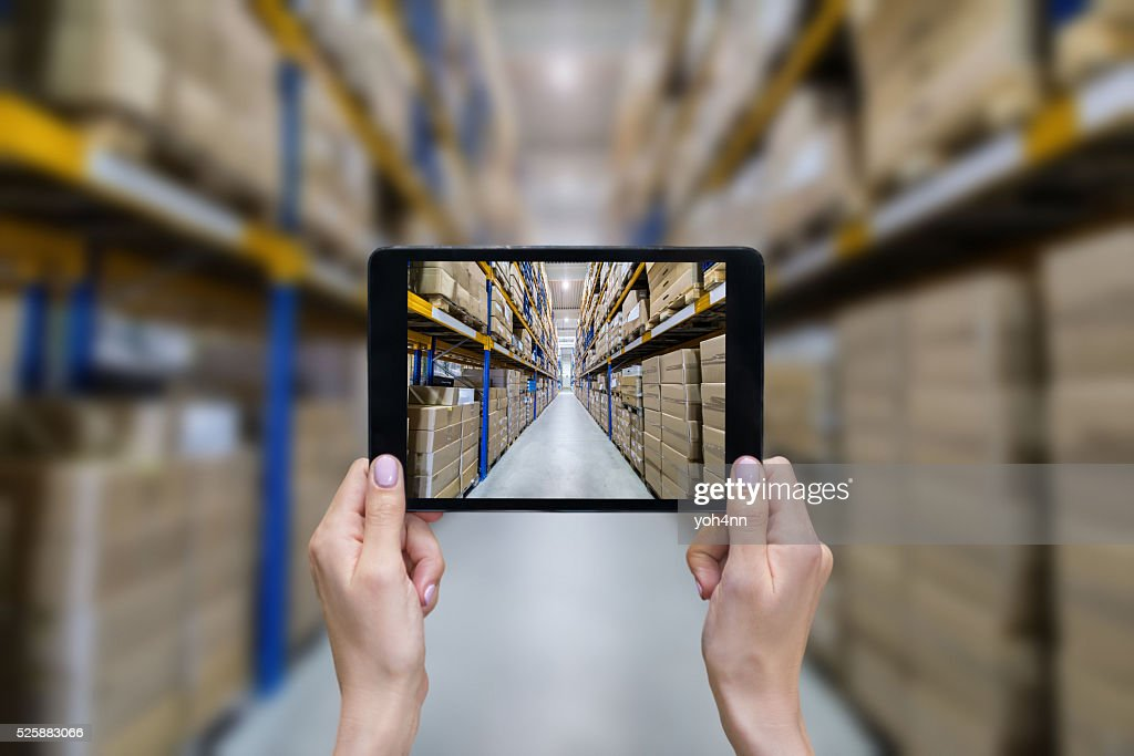 Ordering on-line from modern warehouse : Stock Photo