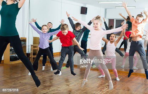 Ordinary boys and girls studying contemp dance : Stock Photo