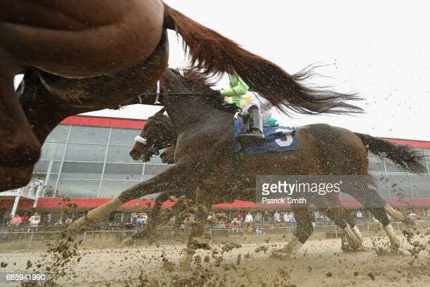 Ore Pass ridden by jockey Scott Spieth race in the first race of the day prior to the 142nd running of the Preakness Stakes at Pimlico Race Course on...
