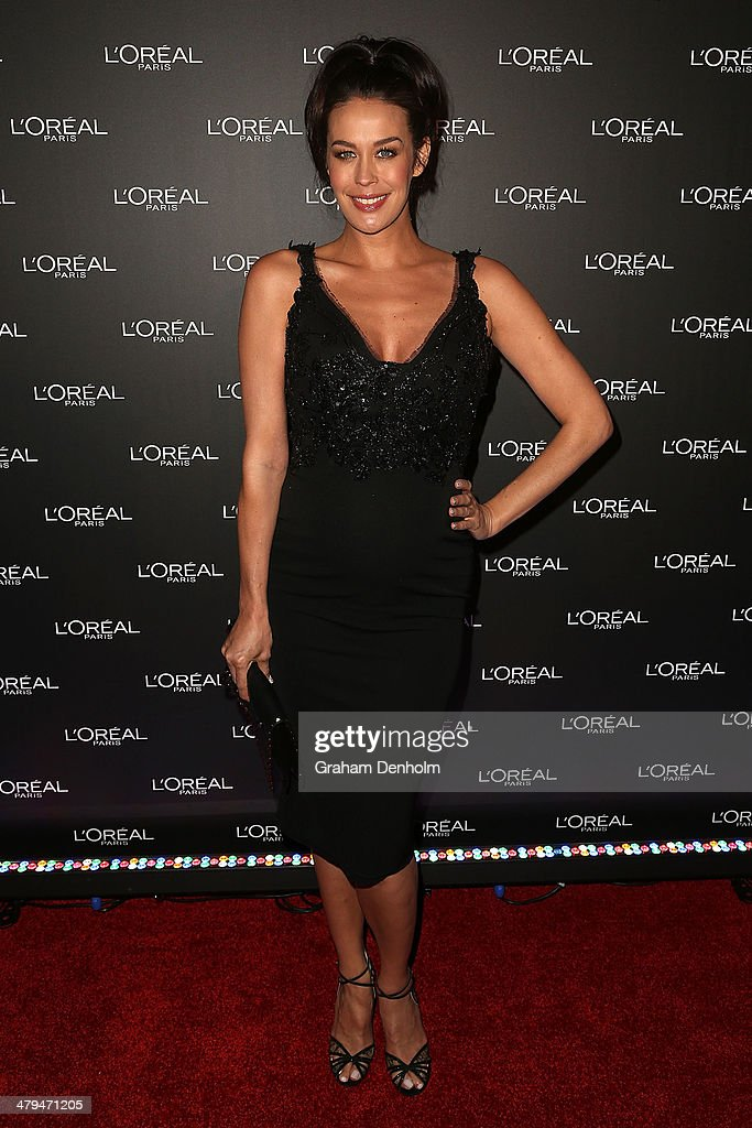 L'Oreal ambassador <a gi-track='captionPersonalityLinkClicked' href=/galleries/search?phrase=Megan+Gale&family=editorial&specificpeople=202042 ng-click='$event.stopPropagation()'>Megan Gale</a> poses as she arrives at a VIP event as part of the 2014 Virgin Australia Melbourne Fashion Festival at Vue De Monde on March 19, 2014 in Melbourne, Australia.