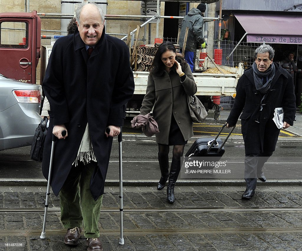L'Oreal heiress Lilian Bettencourt's former financial advisor Patrice de Maistre (L) arrives with his lawyers Pierre Haik and Jacqueline Laffont, on February 11, 2013 at Bordeaux's courthouse for an hearing with a judge as part of the Bettencourt case.