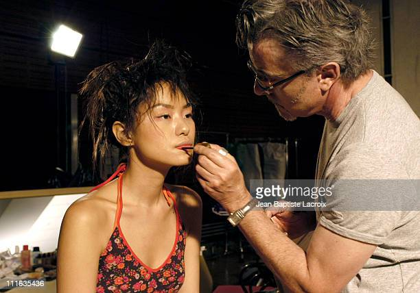 L'Oreal makeup artist at work during Trophy Saint Roch 2003 Fashion Show Backstage at Carrousel du Louvre in Paris France