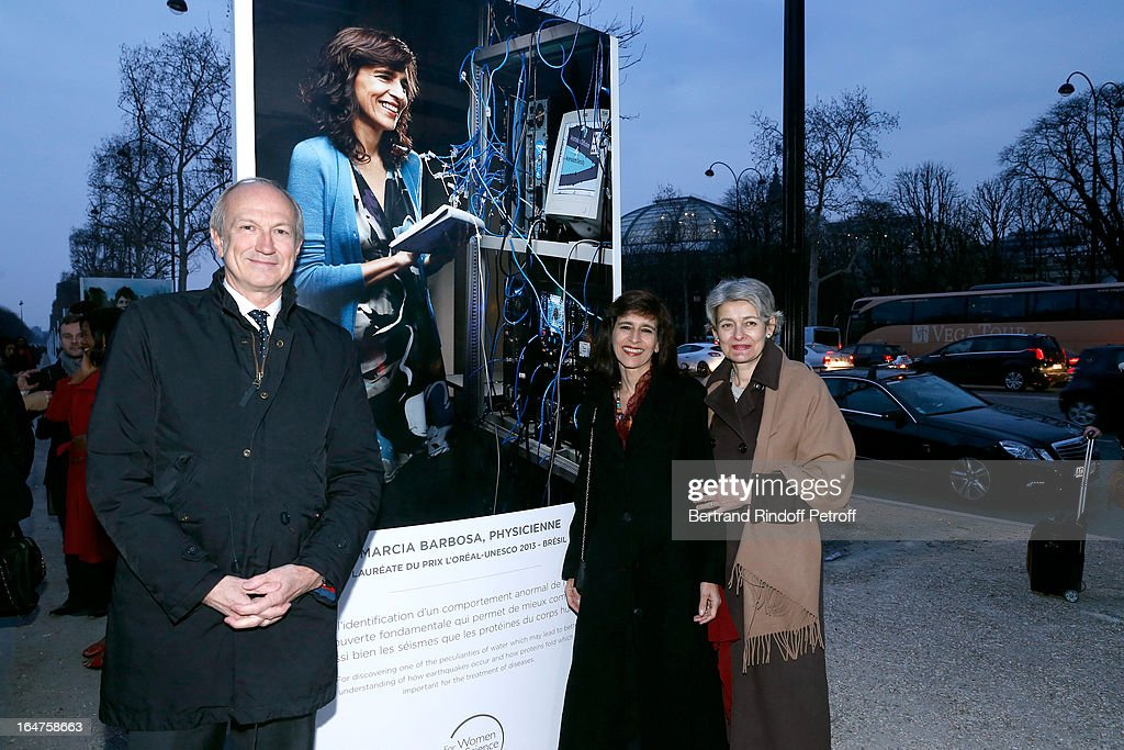 L'Oreal President Jean-Paul Agon, Physicist Marcia Barbosa (Graduate 2013 for Latin America) and UNESCO General Director <a gi-track='captionPersonalityLinkClicked' href=/galleries/search?phrase=Irina+Bokova&family=editorial&specificpeople=6324408 ng-click='$event.stopPropagation()'>Irina Bokova</a> attend Opening of Photo Exhibition for the 15th anniversary of 'L'Oreal-UNESCO Awards For Women In Science' At the Champs Elysees on March 27, 2013 in Paris, France.
