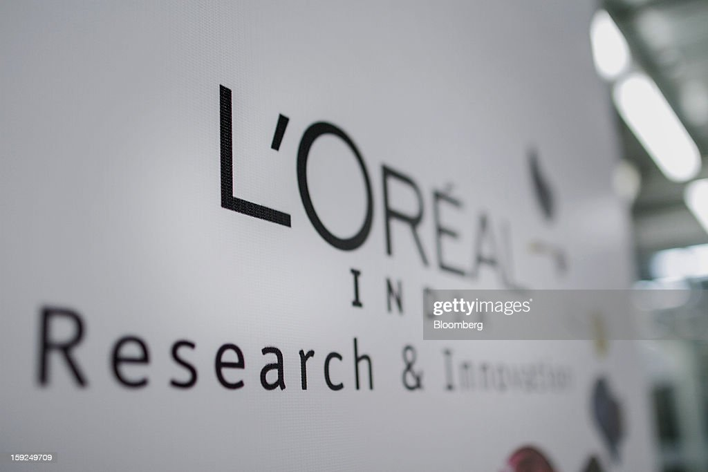 L'Oreal SA signage is displayed at the company's first research and innovation center in Mumbai, India, on Thursday, Jan. 10, 2013. L'Oreal SA, the world's largest cosmetics maker, today inaugurated its new Indian R&I center. Photographer: Dhiraj Singh/Bloomberg via Getty Images
