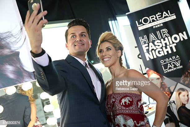 Oreal stylist takes selfie with client at L'Oreal Professionnel Hair Fashion Night At LA Fashion Week on March 17 2016 in Los Angeles California