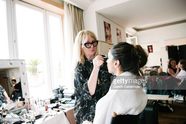 L'Oreals Global MakeUp Director Val Garland prepares Deepika Padukone for the redcarpet during the 70th annual Cannes Film Festival on May 18 2017 in...