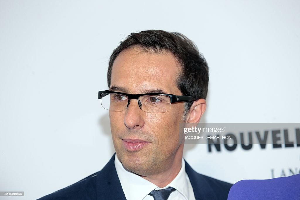 L'Oreal's President Selective Divisions, Nicolas Hieronimus poses as he attends the 'Nouvelle Vague by Lancome' party as part of the 2014/2015 Haute Couture Fall-Winter Paris Fashion Week at the Palais Brongniart in Paris on July 9, 2014. AFP PHOTO / JACQUES DEMARTHON