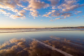 USA, Oregon, Bandon, Cloudy sky reflected in sea