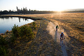 USA, Oregon, Bend, two cyclists on trail by river
