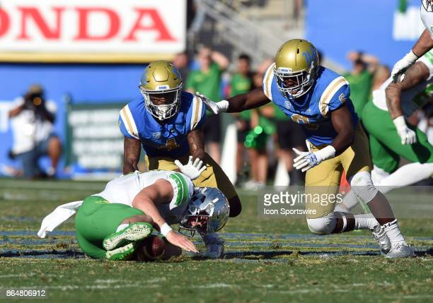 Oregon Braxton Burmeiser dives on the ball after fumbling it during a college football game between the Oregon Ducks and the UCLA Bruins on October...