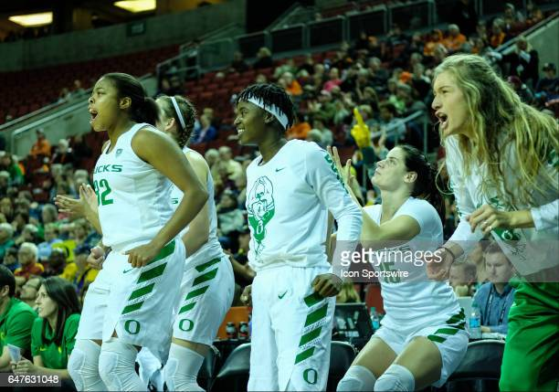 Oregon Ducks bench celebrates during the woman's Pac 12 college tournament game between the Arizona Wildcats and the Oregon Ducks on March 02 at the...