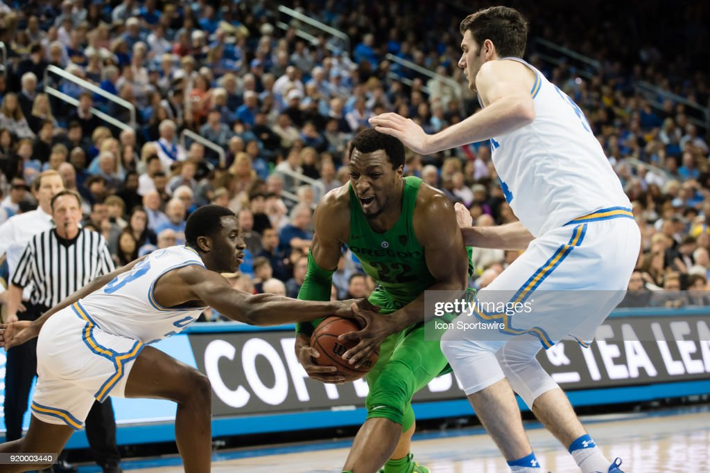 Oregon Ducks forward MiKyle McIntosh (22) drives to the basket with UCLA Bruins guard Kris Wilkes (13) and UCLA Bruins forward Gyorgy Goloman (14) defending during the game between the Oregon Ducks and the UCLA Bruins on February 17, 2018, at Pauley Pavilion in Los Angeles, CA.