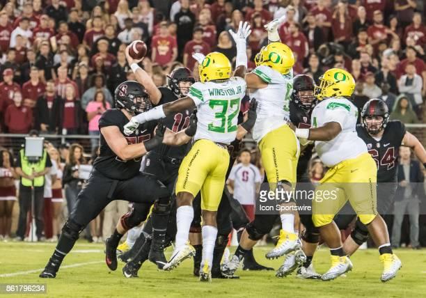 Oregon Ducks linebacker La'Mar Winston Jr and Oregon Ducks defensive lineman Scott Pagano set up a pass screen against Stanford Cardinal quarterback...