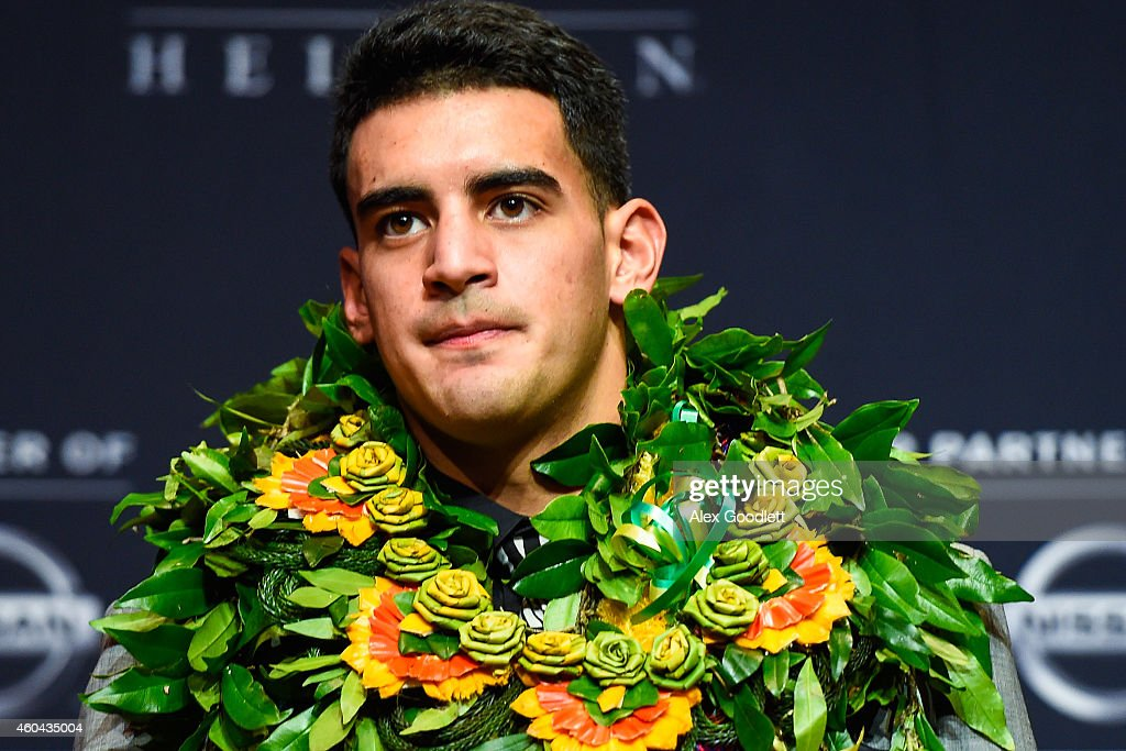 Oregon Ducks quarterback Marcus Mariota speaks to the media during a press conference after the 2014 Heisman Trophy presentation at the New York Marriott Marquis on December 13, 2014 in New York City.