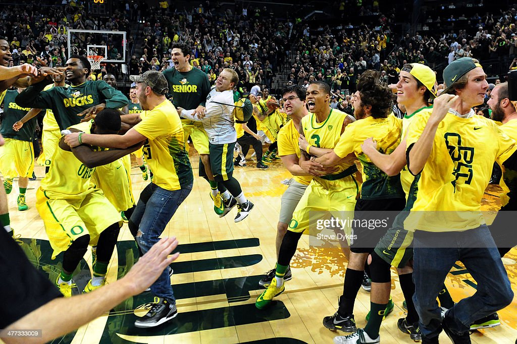 Oregon fans storm the court after the game against the Arizona Wildcats at Matthew Knight Arena on March 8, 2014 in Eugene, Oregon. Oregon won the game 64-57.
