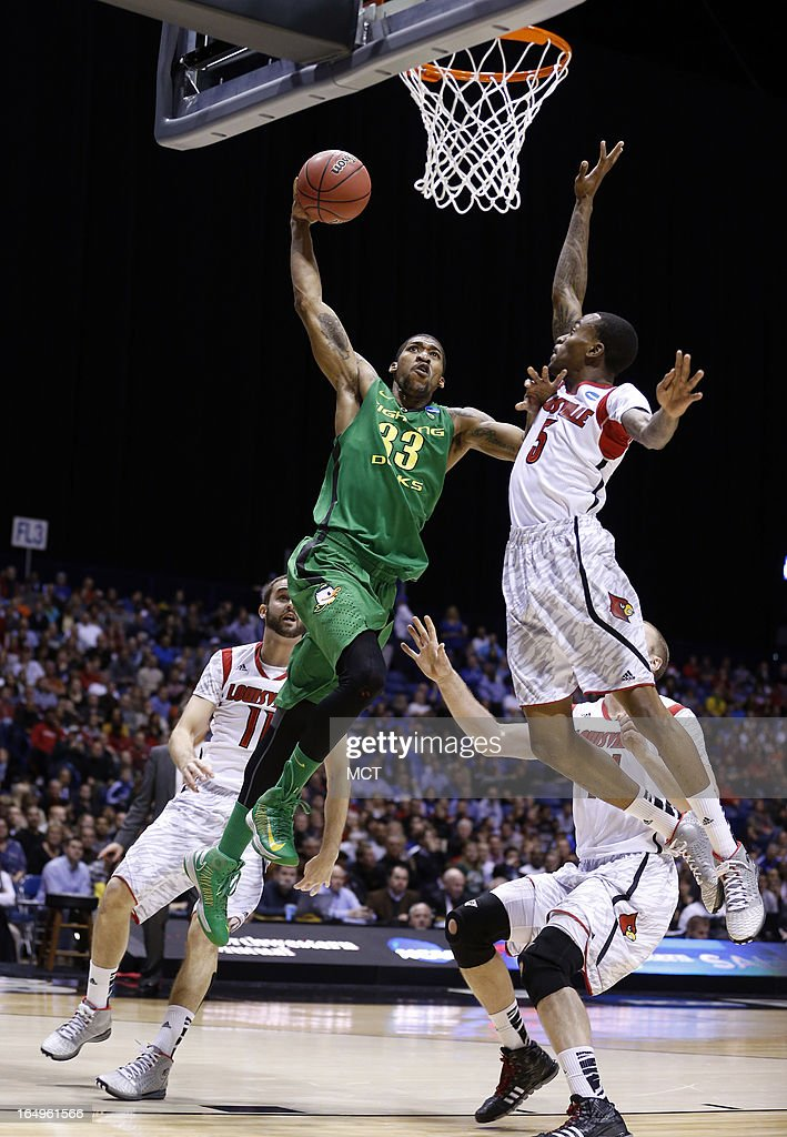 Oregon forward Carlos Emory goes up against Louisville guard Kevin Ware in first half action in their NCAA fourth round game on Friday March 29 in...