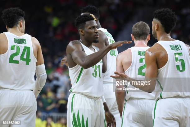 Oregon guard Dylan Ennis and Oregon guard Tyler Dorsey celebrate after a play during the quarterfinal game of the Pac12 Tournament between the...