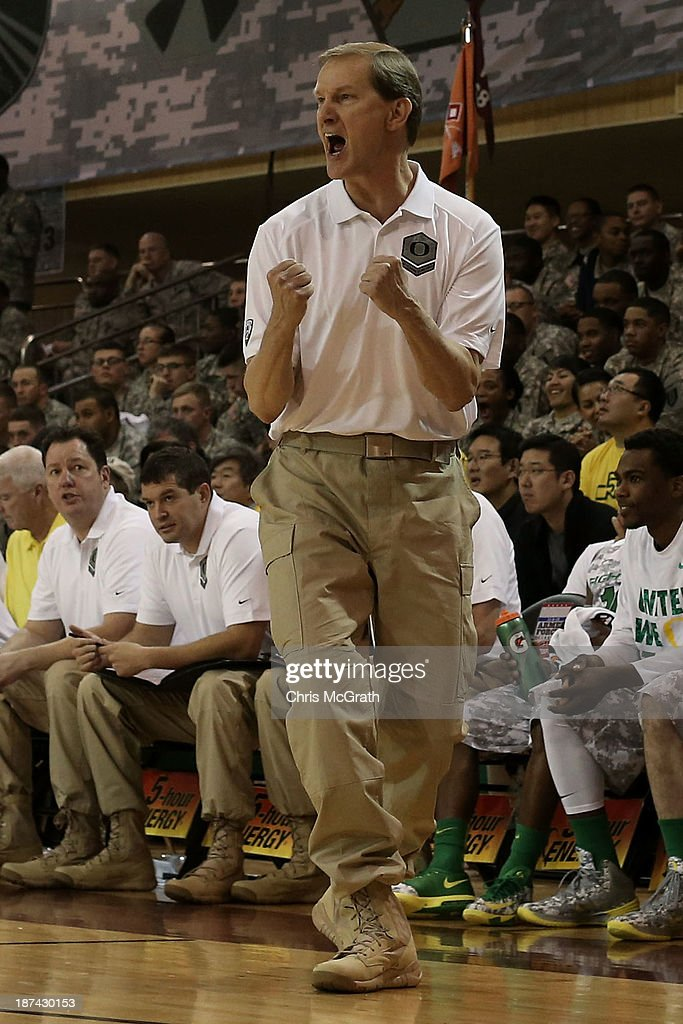 Oregon head coach Dana Altman celebrates a basket against the Georgetown Hoyas during the Armed Forces Classic at United States Army Garrison-Humphreys on November 9, 2013 in Pyeongtaek, South Korea.