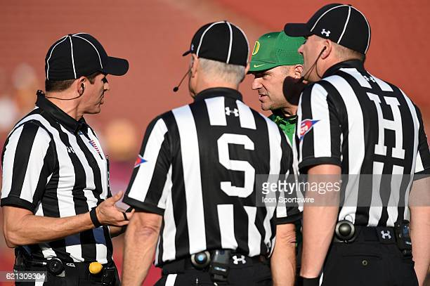 Oregon head coach Mark Helfrich looking frustrated while a play is under review during an NCAA football game between the Oregon Ducks and the USC...