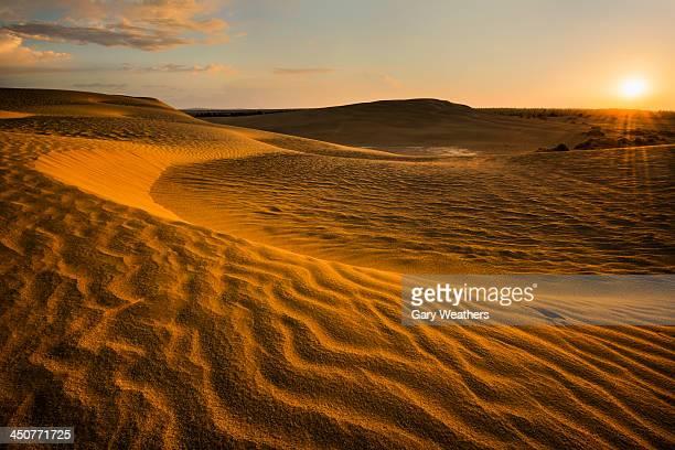 USA, Oregon, Lake County, Sunrise over sand dunes