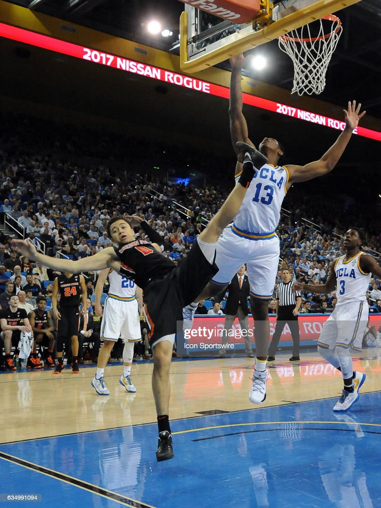 Oregon State Beavers Guard Jaquori McLaughlin (0) Gets Sent Towards The  Floor By UCLA