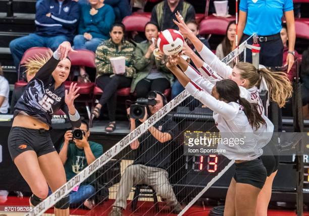 Oregon State outside hitter MaryKate Marshall gets a shot pas tStanford middle blocker Tami Alade during the regular season game between the Oregon...