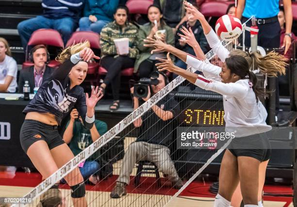 Oregon State outside hitter MaryKate Marshall watches her slam sail by Stanford middle blocker Tami Alade during the regular season game between the...