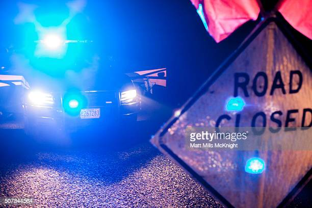 Oregon State Troopers setup a road block during the evening that moved media further away from Malheur National Wildlife Refuge January 28 2016 near...