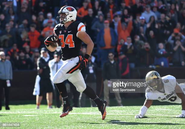 Oregon State University RB Ryan Nall runs past University of Colorado DB Evan Worthington for a second half touchdown during a college football game...