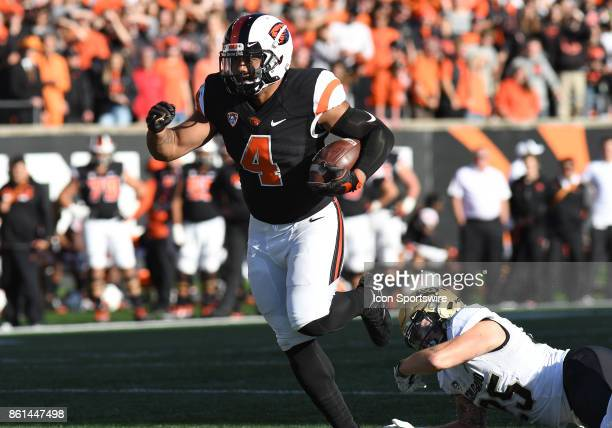 Oregon State University RB Thomas Tyner runs for positive yardage during a college football game between the Colorado Buffaloes and Oregon State...