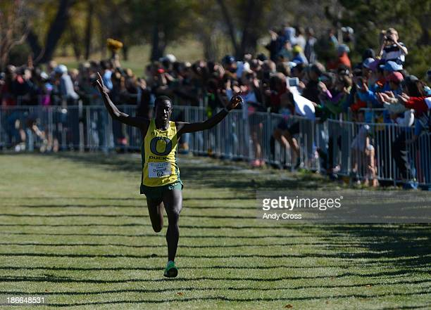Oregon University runner Edward Cheserek celebrates his huge lead moments before crossing the finish line in first place to win the Pac 12 Cross...