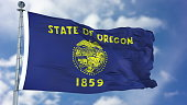 Oregon (U.S. state) flag waving against clear blue sky, close up, isolated with clipping path mask luma channel, perfect for film, news, composition