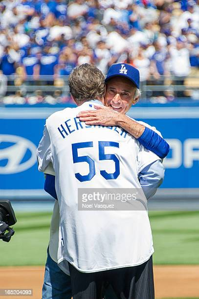 Orel Hershiser and Sandy Koufax attend a baseball game between the San Francisco Giants and the Los Angeles Dodgers at Dodger Stadium on April 1 2013...