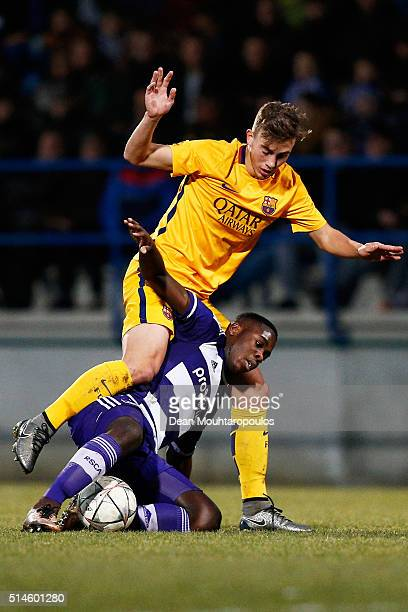 Orel Mangala of Anderlecht battles for the ball with Oriol Busquets Mas of Barcelona during the UEFA Youth League Quarterfinal match between...