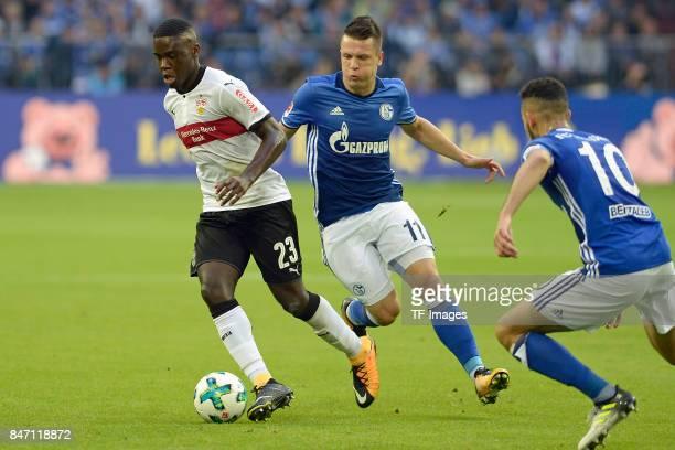 Orel Mangala of Stuttgart and Yevhen Konoplyanka of Schalke and Nabil Bentaleb of Schalke battle for the ball during the Bundesliga match between FC...