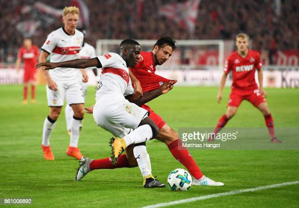 Orel Mangala of VfB Stuttgart is challenged by Claudio Pizarro of 1FC Koeln during the Bundesliga match between VfB Stuttgart and 1 FC Koeln at...