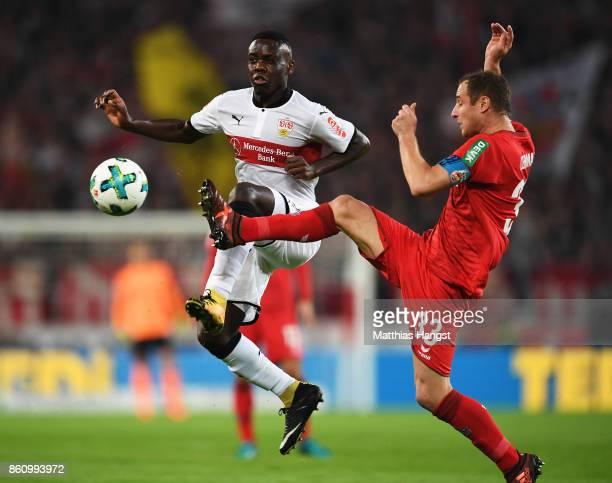 Orel Mangala of VfB Stuttgart is challenged by Mathias Lehmann of 1FC Koeln during the Bundesliga match between VfB Stuttgart and 1 FC Koeln at...