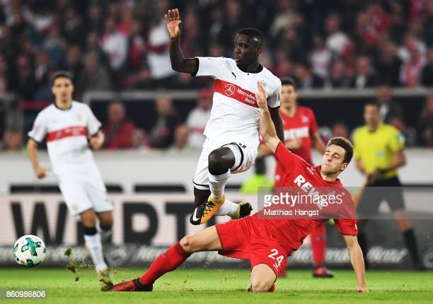 Orel Mangala of VfB Stuttgart is tackled by Lukas Kluenter of 1FC Koeln during the Bundesliga match between VfB Stuttgart and 1 FC Koeln at...