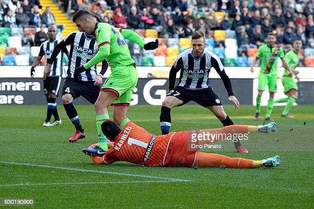 Orestis Karnezis goalkeeper of Udinese Calcio saves a shot from Marcello Trotta of FC Crotone during the Serie A match between Udinese Calcio and FC...