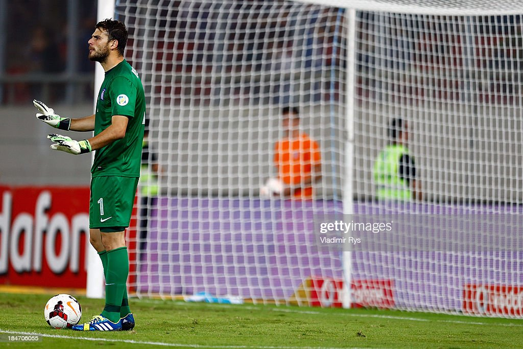 Orestis Karnezis of Greece gives instructions to his team mates during the group G FIFA 2014 World Cup Qualifier match between Greece and Liechtenstein at Karaiskakis Stadium on October 15, 2013 in Athens, Greece.