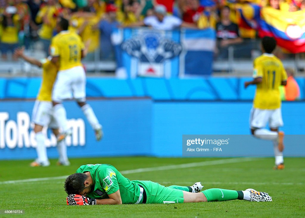 Orestis Karnezis of Greece (C) shows his dejection after James Rodriguez of Colombia scores the third goal during the 2014 FIFA World Cup Brazil Group C match between Colombia and Greece at Estadio Mineirao on June 14, 2014 in Belo Horizonte, Brazil.