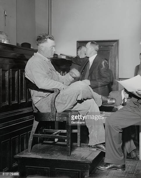 Orey Dobbins a farmer who testified during the first trial of the Scottsboro Negroes is seen here on the stand in court in Decatur Alabama as he was...