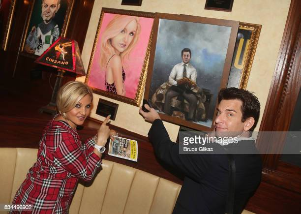 Orfeh and husband Andy Karl pose with their portraits at the Broadway Wall of Fame unveiling to honor Andy Karl for his role in 'Groundhog Day' at...