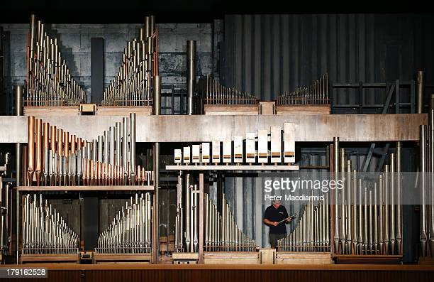 Organ builder John Oliver inspects a pipe at the Royal Festival Hall organ at Southbank Centre on August 30 2013 in London England Recently unveiled...