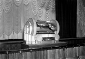Organ console in the auditorium at the Odeon Leicester Square London 1937 Bearing the Odeon logo the Art Deco organ reflects the contemporary style...